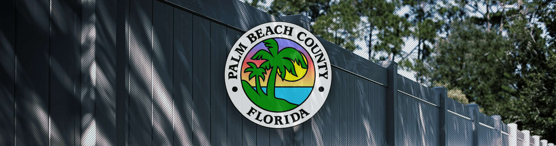 Vinyl fence with palm beach county logo